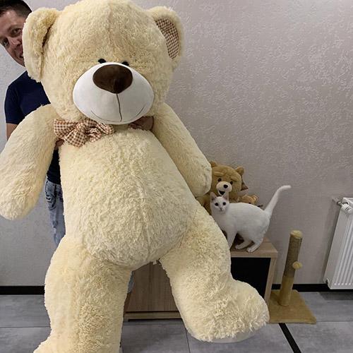 Великий плюшевий ведмедик фото